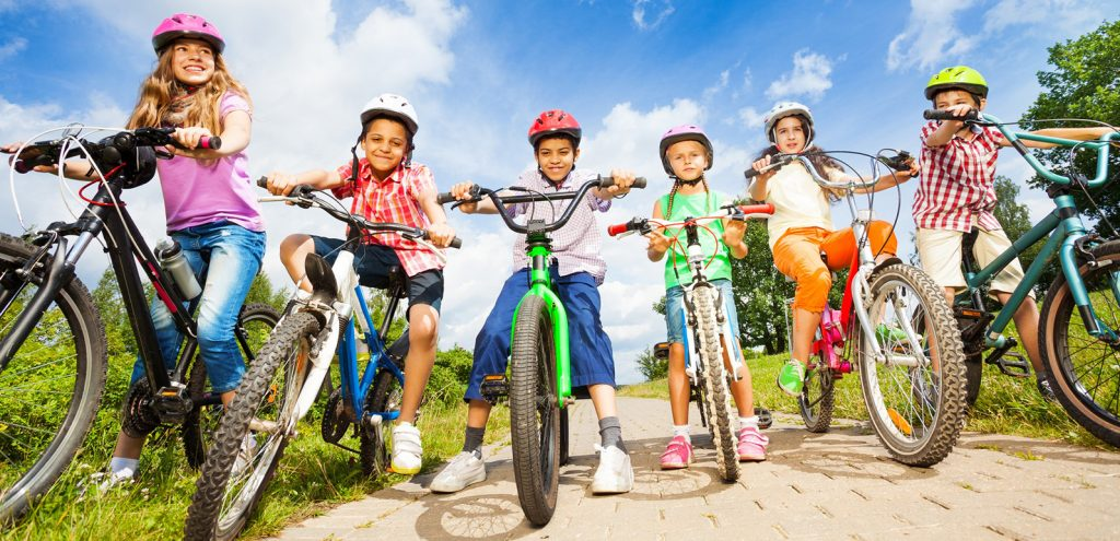 children-with-helmets-riding-bikes-iStock-508726663-web-ready-1024x495