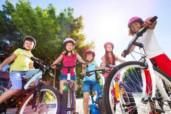 family-riding-bikes-safely