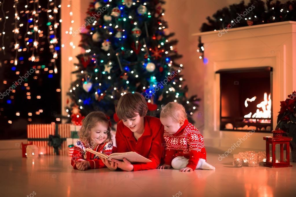 depositphotos_87291622-stock-photo-kids-reading-a-book-on