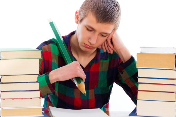 Frustrated woeful student because of learning difficulties.